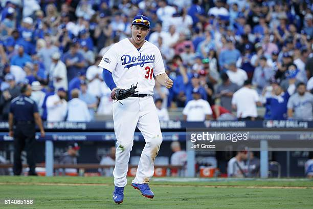 Joc Pederson of the Los Angeles Dodgers celebrates their 6 to 5 victory over the Washington Nationals during game four of the National League...