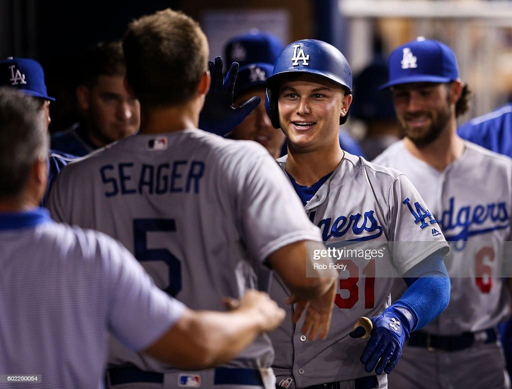 Joc Pederson #31 of the Los Angeles Dodgers celebrates with teammates in the dugout after hitting a home run during the game against the Miami Marlins at Marlins Park on September 10, 2016 in Miami, Florida.