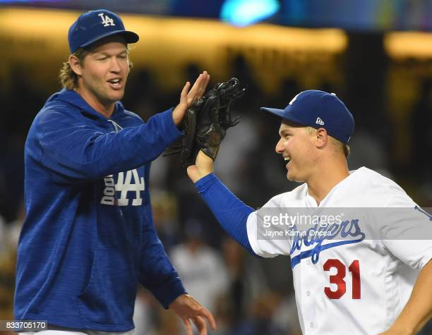 Joc Pederson of the Los Angeles Dodgers gets a high five from Clayton Kershaw after the game against the Chicago White Sox at Dodger Stadium on...