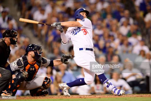 Joc Pederson of the Los Angeles Dodgers hits a solo home run during the fifth inning against the Houston Astros in game two of the 2017 World Series...