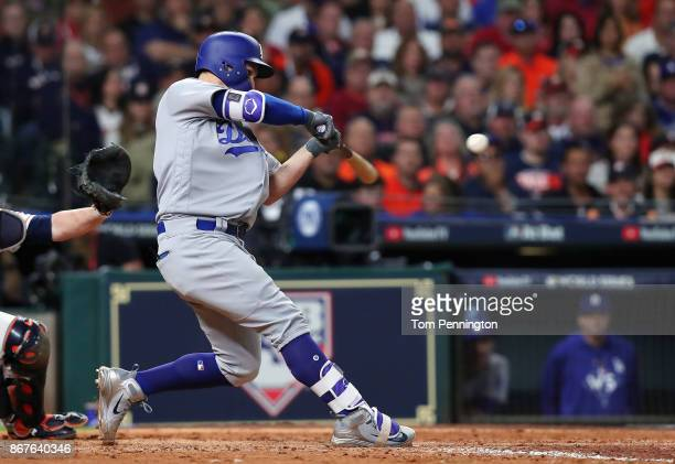 Joc Pederson of the Los Angeles Dodgers hits a threerun home run during the ninth inning against the Houston Astros in game four of the 2017 World...