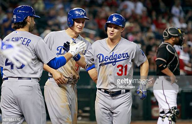 Joc Pederson of the Los Angeles Dodgers is congratulated by teammates Corey Seager and Mike Bolsinger following his tworun home run against the...