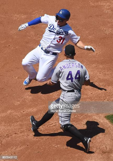 Joc Pederson of the Los Angeles Dodgers is tagged out at third by Tyler Anderson of the Colorado Rockies in the game at Dodger Stadium on June 25...