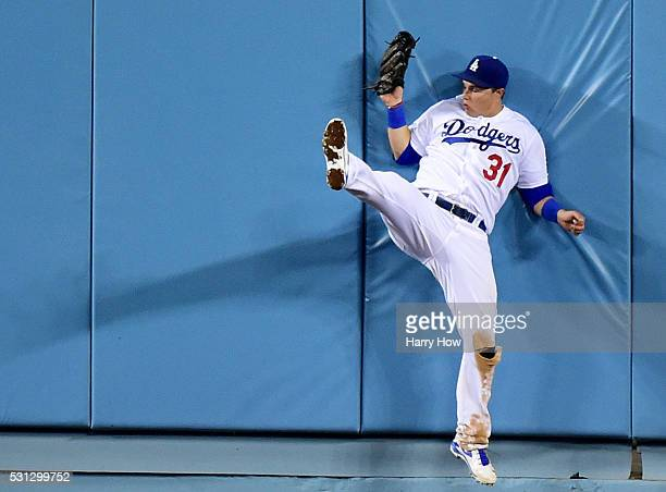 Joc Pederson of the Los Angeles Dodgers makes a catch at the wall for an out of Matt Holliday of the St Louis Cardinals during the seventh inning at...