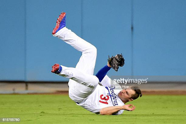 Joc Pederson of the Los Angeles Dodgers makes a catch on a ball hit by Javier Baez of the Chicago Cubs in the sixth inning in game four of the...