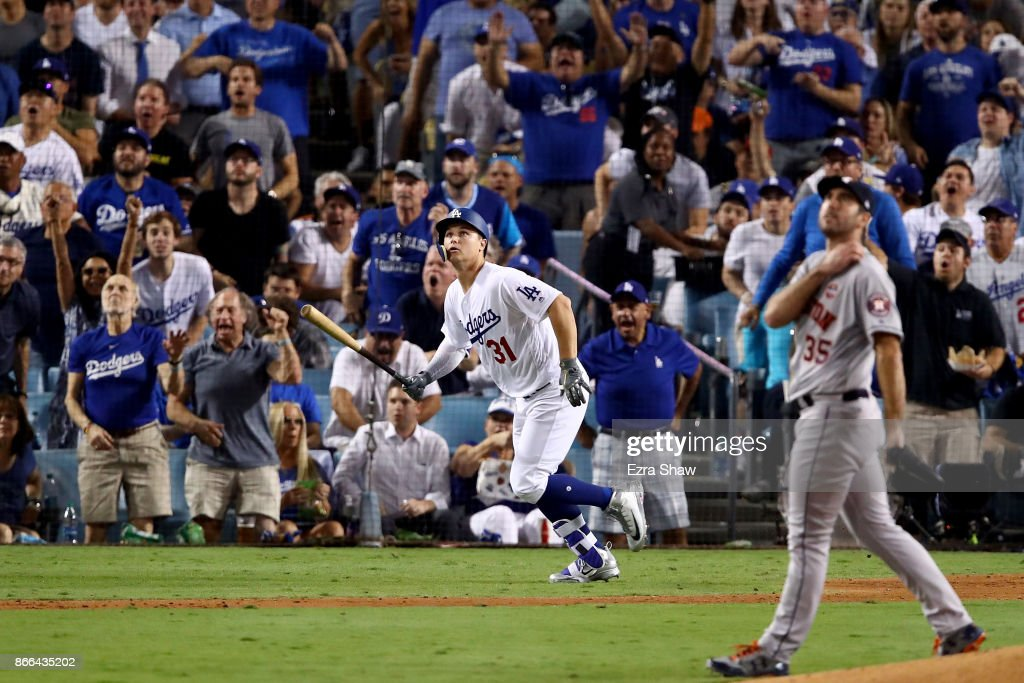 Joc Pederson #31 of the Los Angeles Dodgers reacts after hitting a solo home run during the fifth inning against the Houston Astros in game two of the 2017 World Series at Dodger Stadium on October 25, 2017 in Los Angeles, California.