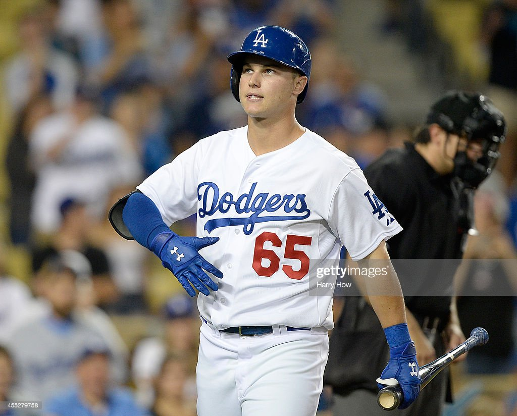 <a gi-track='captionPersonalityLinkClicked' href=/galleries/search?phrase=Joc+Pederson&family=editorial&specificpeople=9750060 ng-click='$event.stopPropagation()'>Joc Pederson</a> #65 of the Los Angeles Dodgers reacts at the plate in his MLB debut against the Washington Nationals during the ninth inning at Dodger Stadium on September 1, 2014 in Los Angeles, California.
