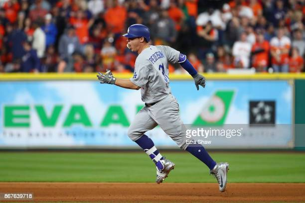Joc Pederson of the Los Angeles Dodgers rounds the bases after a hitting a threerun home run during the ninth inning against the Houston Astros in...