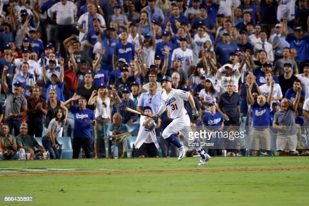 Joc Pederson of the Los Angeles Dodgers runs the bases after hitting a solo home run during the fifth inning against the Houston Astros in game two...