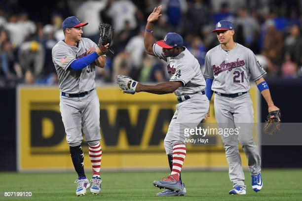 Joc Pederson Yasiel Puig and Trayce Thompson of the Los Angeles Dodgers celebrate after the final out during the game against the San Diego Padres at...