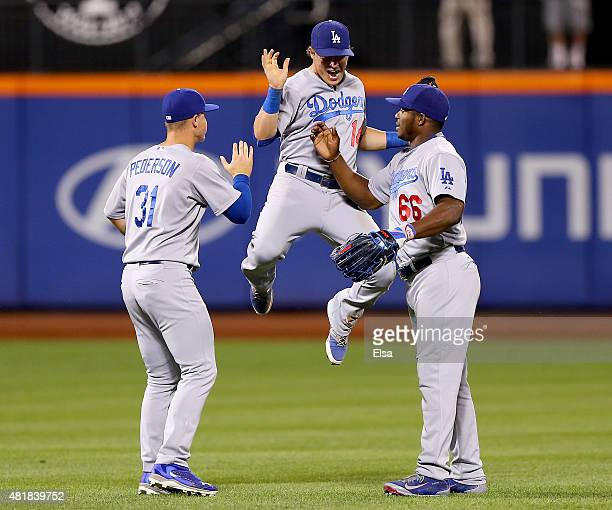 Joc PedersonEnrique Hernandez and Yasiel Puig of the Los Angeles Dodgers celebrate the win over the New York Mets on July 24 2015 at Citi Field in...