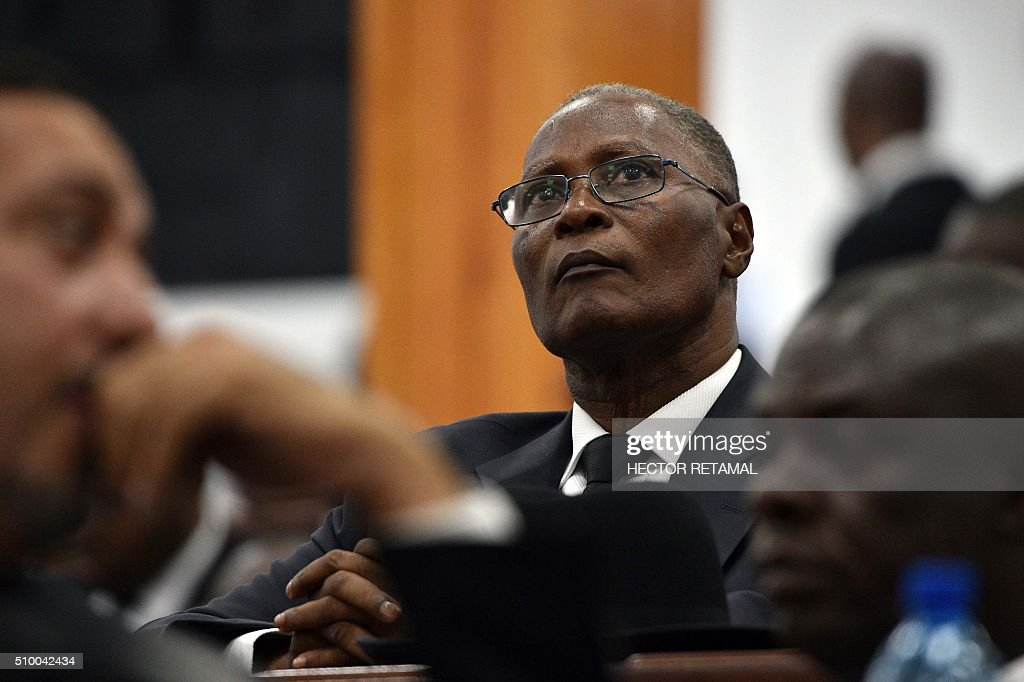 Jocelerme Privert, candidate to be provisional president, listens as Haitian lawmakers prepare to elect an interim president on February 13, 2016 at the Haitian Parliament in Port-au-Prince. Haitian lawmakers were set to elect an interim president to fill the power vacuum following the departure of Michel Martelly, after a vote to choose his replacement was postponed over fears of violence. Thirteen candidates applied to run in the election but only three paid the fee of 500,000 gourdes (about $8,400) and will participate. RETAMAL