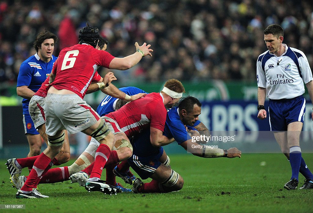 Jocelino Suta of France is tackled during the RBS Six Nations match between France and Wales at Stade de France on February 9, 2013 in Paris, France.