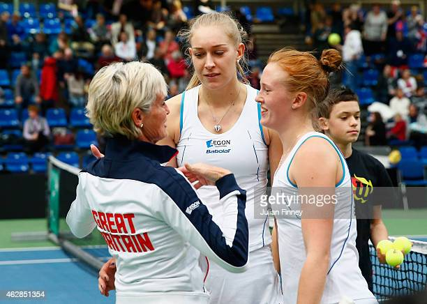 Jocelyn Rae and Anna Smith of Great Britain are congratulated by Captain Judy Murray after defeating Elina Svitolina and Olga Savchuk of Ukraine in...