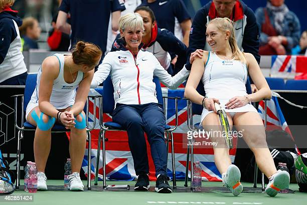 Jocelyn Rae and Anna Smith of Great Britain are congratulated by Captain Judy Murray after they took the second set against Elina Svitolina and Olga...