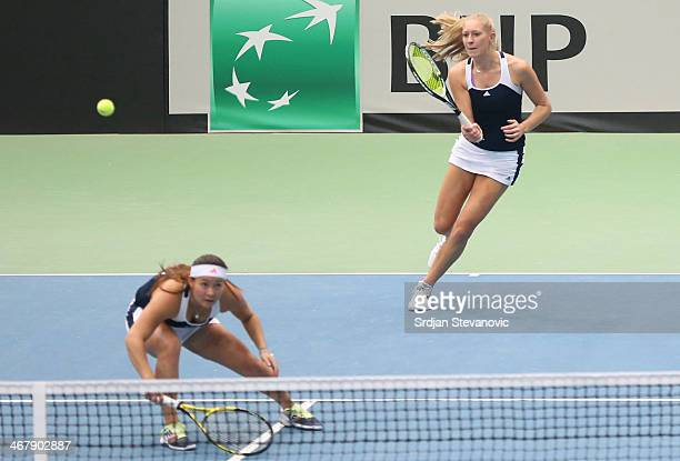 Jocelyn Rae and Tara Moore of Great Britain in action during the match against Timea Babos and Jani LucaReka of Hungary during the day three of Fed...