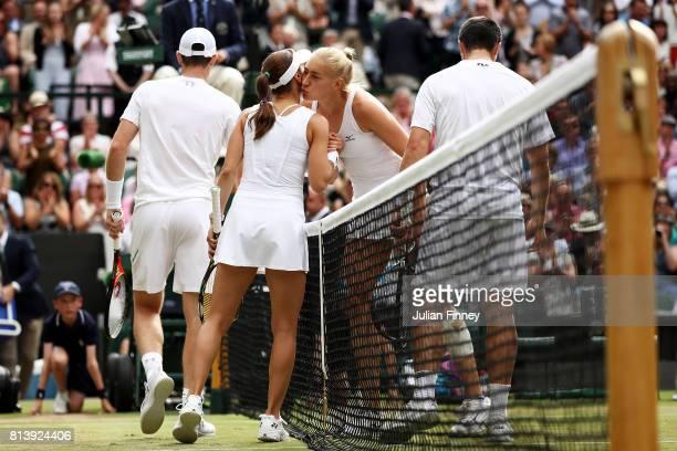 Jocelyn Rae of Great Britain partnering Ken Skupski of Great Britain kisses Martina Hingis of Switzerland partnering Jamie Murray of Great Britain...
