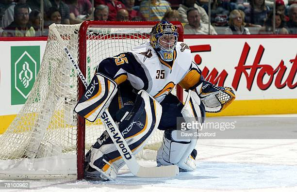 Jocelyn Thibault of the Buffalo Sabres keeps an eye on the play against the Montreal Canadiens during their NHL game at the Bell Centre November 24...