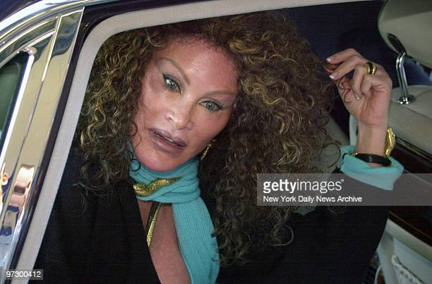 Jocelyne Wildenstein climbs into her car after auctioning off her collection of cat jewelry at Sotheby's