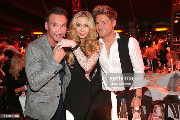 Jochen Bendel and his husband Matthias Pridoehl and Dolly Buster during the VIP premiere of Schubeck's Teatro at Spiegelzelt on November 3 2016 in...