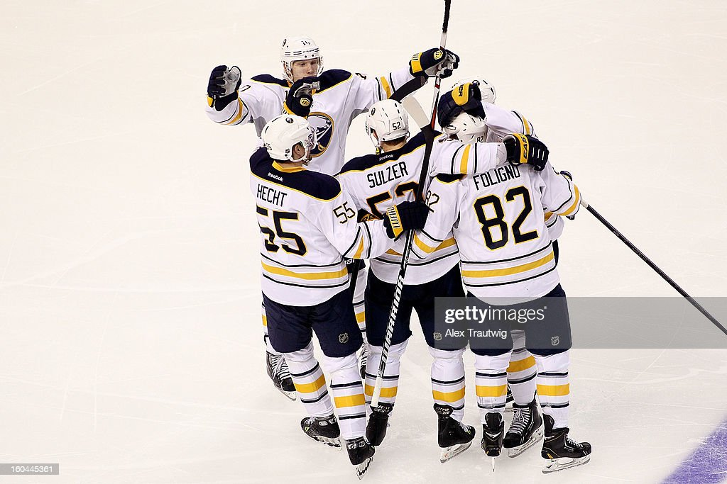 Jochen Hecht #55, Christian Ehrhoff #10, Alexander Sulzer #52 and Marcus Foligno #82 of the Buffalo Sabres celebrate a third-period goal against the Boston Bruins during a game at the TD Garden on January 31, 2013 in Boston, Massachusetts. The Sabres defeated the Bruins 7-4.