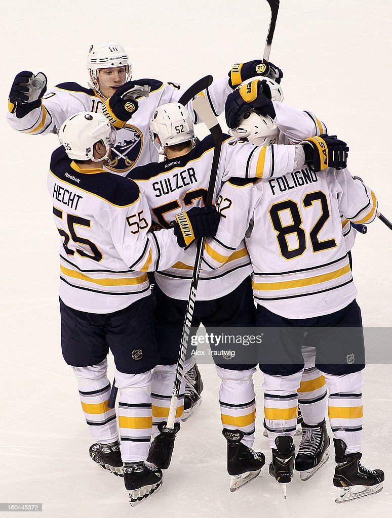 Jochen Hecht #55, Christian Ehrhoff #10, Alexander Sulzer #52 and Marcus Foligno #82 of the Buffalo Sabres celebrate a third period goal against the Boston Bruins during a game at the TD Garden on January 31, 2013 in Boston, Massachusetts. The Sabres defeated the Bruins 7-4.