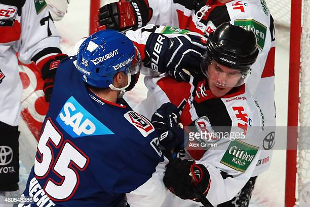Jochen Hecht of Mannheim fights with Christopher Minard of Koeln during the DEL match between Adler Mannheim and Koelner Haie at SAP Arena on...