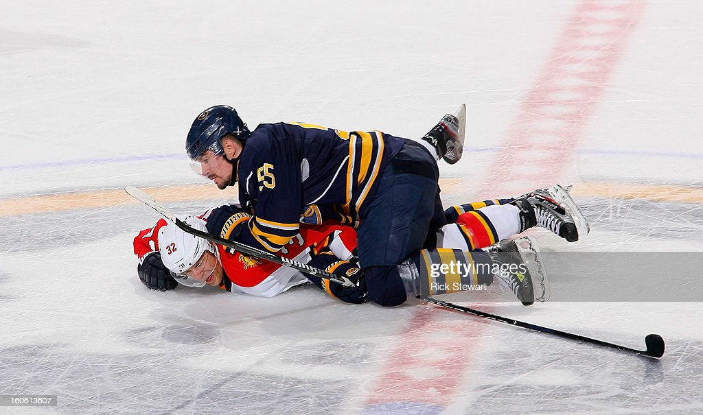 <a gi-track='captionPersonalityLinkClicked' href=/galleries/search?phrase=Jochen+Hecht&family=editorial&specificpeople=203184 ng-click='$event.stopPropagation()'>Jochen Hecht</a> #55 of the Buffalo Sabres pushes Kris Versteeg #32 of the Florida Panthers down to the ice at First Niagara Center on February 3, 2013 in Buffalo, New York. Florida won 4-3.