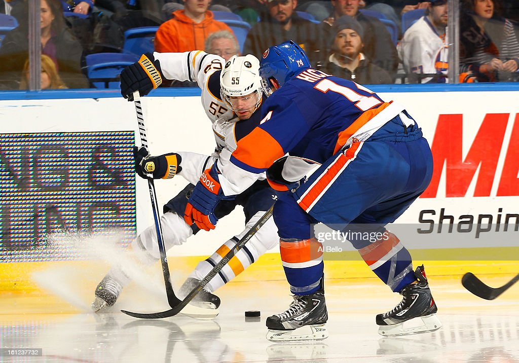 Jochen Hecht #55 of the Buffalo Sabres skates against Thomas Hickey #14 of the New York Islanders during their game at Nassau Veterans Memorial Coliseum on February 9, 2013 in Uniondale, New York.