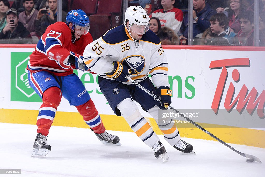<a gi-track='captionPersonalityLinkClicked' href=/galleries/search?phrase=Jochen+Hecht&family=editorial&specificpeople=203184 ng-click='$event.stopPropagation()'>Jochen Hecht</a> #55 of the Buffalo Sabres skates with the puck while being chased by <a gi-track='captionPersonalityLinkClicked' href=/galleries/search?phrase=Alex+Galchenyuk&family=editorial&specificpeople=7419137 ng-click='$event.stopPropagation()'>Alex Galchenyuk</a> #27 of the Montreal Canadiens during the NHL game at the Bell Centre on February 2, 2013 in Montreal, Quebec, Canada. The Canadiens defeated the Sabres 6-1.