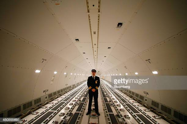 Jochen Mertel a pilot for Deutsche Lufthansa AG poses for a photograph in in the hold of a Lufthansa Cargo Boeing 777F freighter aircraft at...
