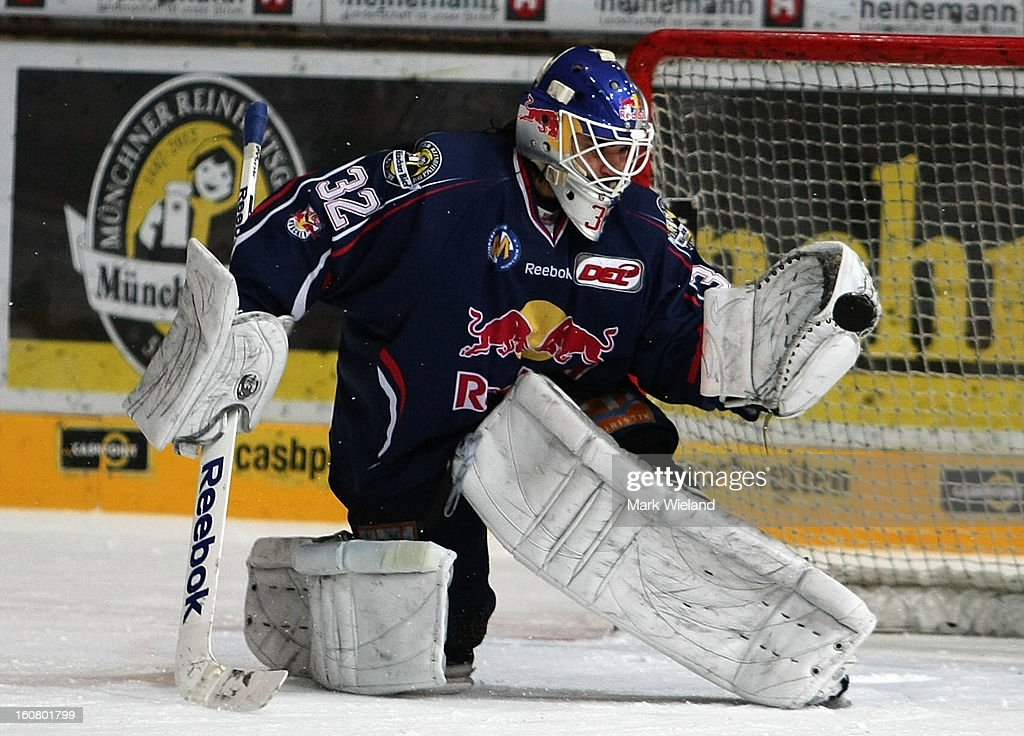 <a gi-track='captionPersonalityLinkClicked' href=/galleries/search?phrase=Jochen+Reimer&family=editorial&specificpeople=4671801 ng-click='$event.stopPropagation()'>Jochen Reimer</a> of EHC Muenchen makes a save in the penalty shoot out during the DEL match between EHC Muenchen and Koelner Haie at Olympia Eishalle on February 3, 2013 in Munich, Germany.