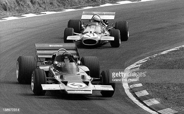 Jochen Rindt of Austria drives the Gold Leaf Team Lotus Lotus 72C Ford V8 ahead of Jack Brabham of Australia driving the Brabham Racing Organisation...