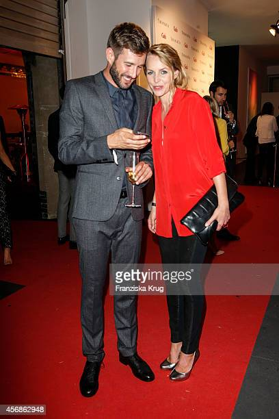 Jochen Schropp and Simone Hanselmann attend the Tiffany Gala Host 'Streetstyle Meets Red Carpet' Event on October 08 2014 in Berlin Germany