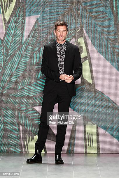Jochen Schropp speaks at the Opening Night by Grazia fashion show during the MercedesBenz Fashion Week Spring/Summer 2015 at Erika Hess Eisstadion on...