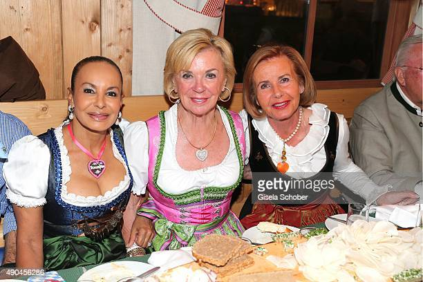 Jochi Sauerland Liz Mohn Bertelsmann and Jimmy Schmied during the 'Sauerland Stammtisch' at Oktoberfest 2015 at Weinzelt /Theresienwiese on September...