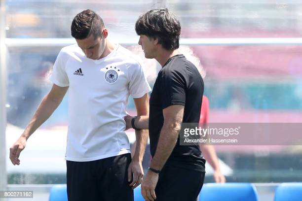 Jochim Loew head coach of team Germany talks to his player Julian Draxler prior to a Germany training session ahead of their FIFA Confederations Cup...