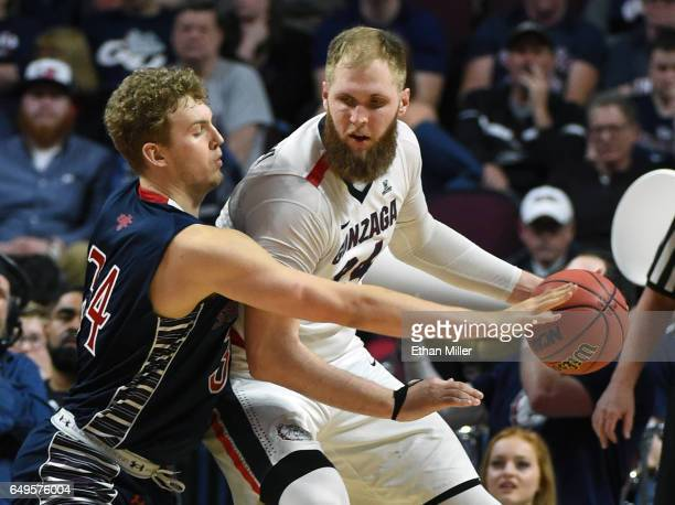 Jock Landale of the Saint Mary's Gaels guards Przemek Karnowski of the Gonzaga Bulldogs during the championship game of the West Coast Conference...