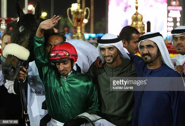 Jockey Ahmad Ajtebi celebrates with Emirati Vice President and Dubai ruler Sheikh Mohammed bin Rashed alMaktoum and his son Sheikh Hamdan bin...