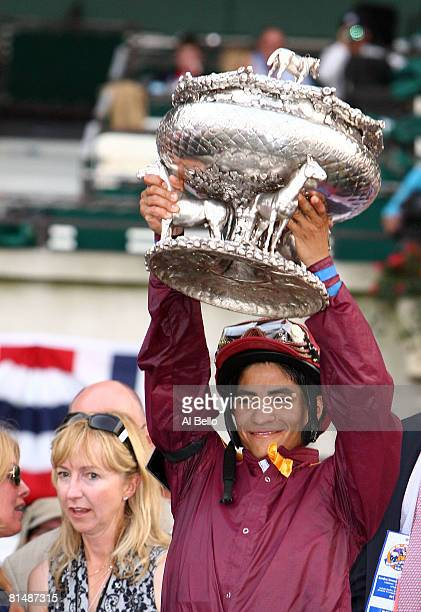 Jockey Alan Garcia celebrates with the trophy after winning atop Da'Tara during the 140th running of the Belmont Stakes at Belmont Park on June 7...
