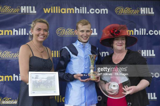 Jockey Ali Rawlinson with representative of the stables Vicki Godfrey and MP Fiona O'Donnell after riding Demora to win The William Hill Scottish...