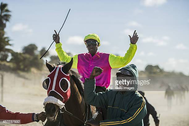 A Jockey and his horse on July 9 2014 in the Kalahari South Africa The event happens the same time as the Durban July event but is nothing like it...