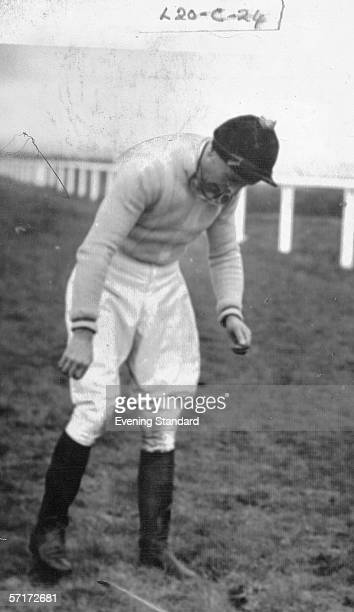 Jockey and later thriller writer Dick Francis rider of the Queen Mother's horse Devon Loch walking dejectedly on the Grand National course after his...