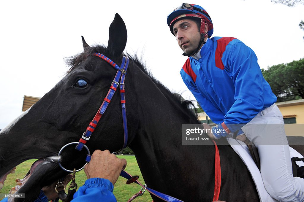 Jockey and owner Federico De Paola mounts his blind racehorse Laghat before the race at Ippodromo San Rossore on January 20, 2013 near Pisa, Italy. Laghat is a ten-year-old Italian racehorse who has won 21 races despite being blind, after being born with a mycosis fungal infection in both eyes. Laghat is trained and owned by jockey Federico De Paola in San Rossore near Pisa and has its own facebook page with many followers. Laghat finished fourth at today's Premio Demet.