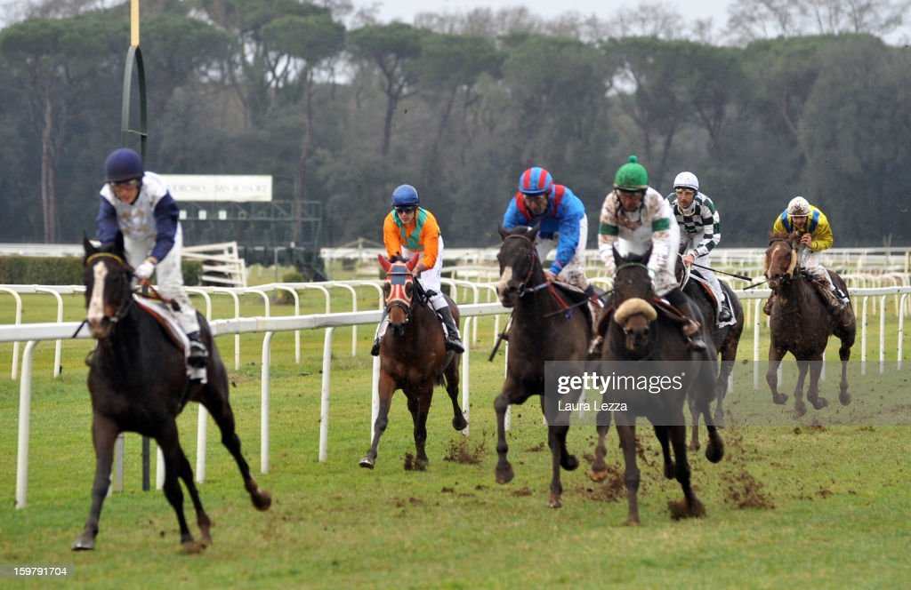 Jockey and owner Federico De Paola rides (3rd L) his blind racehorse Laghat at Ippodromo San Rossore on January 20, 2013 near Pisa, Italy. Laghat is a ten-year-old Italian racehorse who has won 21 races despite being blind, after being born with a mycosis fungal infection in both eyes. Laghat is trained and owned by jockey Federico De Paola in San Rossore near Pisa and has its own facebook page with many followers. Laghat finished fourth at today's Premio Demet.