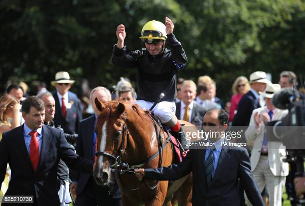 Jockey Andrea Atzeni celebrates on Stradivarius after winning the Qatar Goodwood Cup Stakes during day one of the Qatar Goodwood Festival at Goodwood...