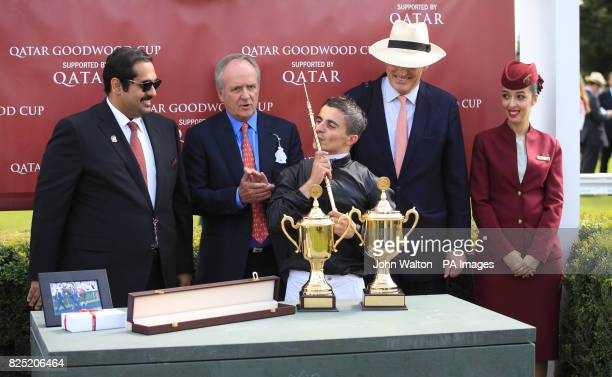 Jockey Andrea Atzeni celebrating with owner Bjorn Nielsen and trainer John Godsen after Stradivarius won the Qatar Goodwood Cup Stakes during day one...