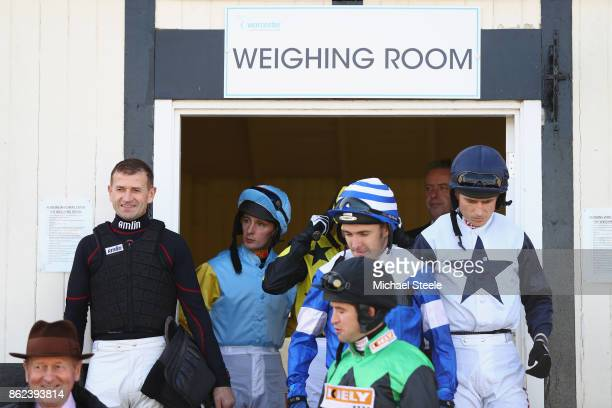 Jockey Andrew Thornton looks on as fellow jockeys head to the parade ring Thornton is returning to the saddle after a ten month injury lay off at...
