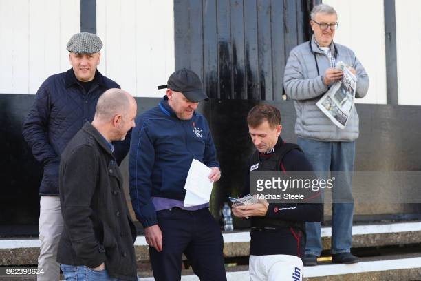 Jockey Andrew Thornton signs autographs as he returns to the saddle after a ten month injury lay off at Worcester Racecourse on October 17 2017 in...