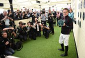 Jockey AP McCoy receives a plaque to mark his inclusion in the 'Hall of Fame' at Aintree Racecourse on the opening day of the Grand National Festival...